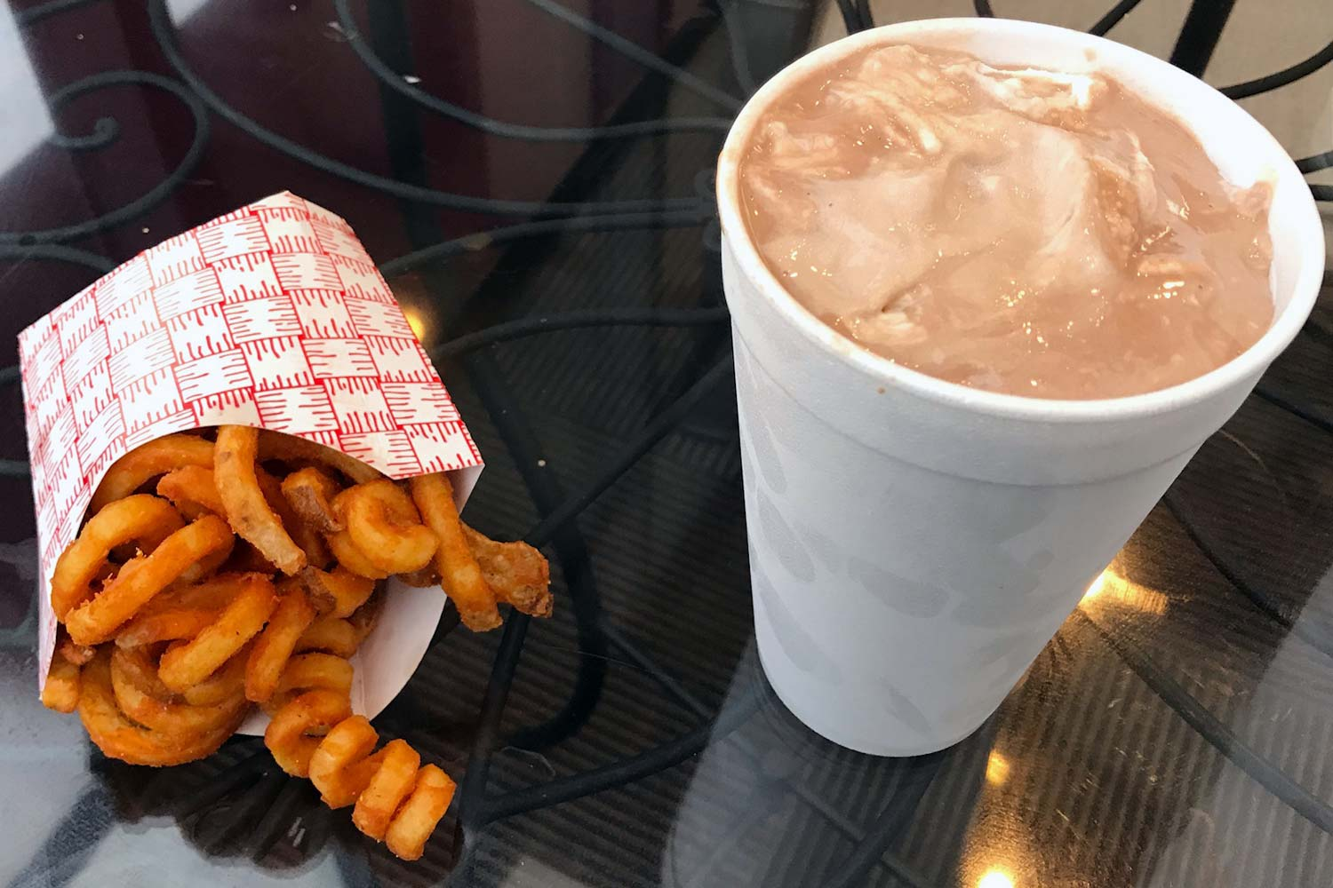 Sliced Deli curly fries and shake