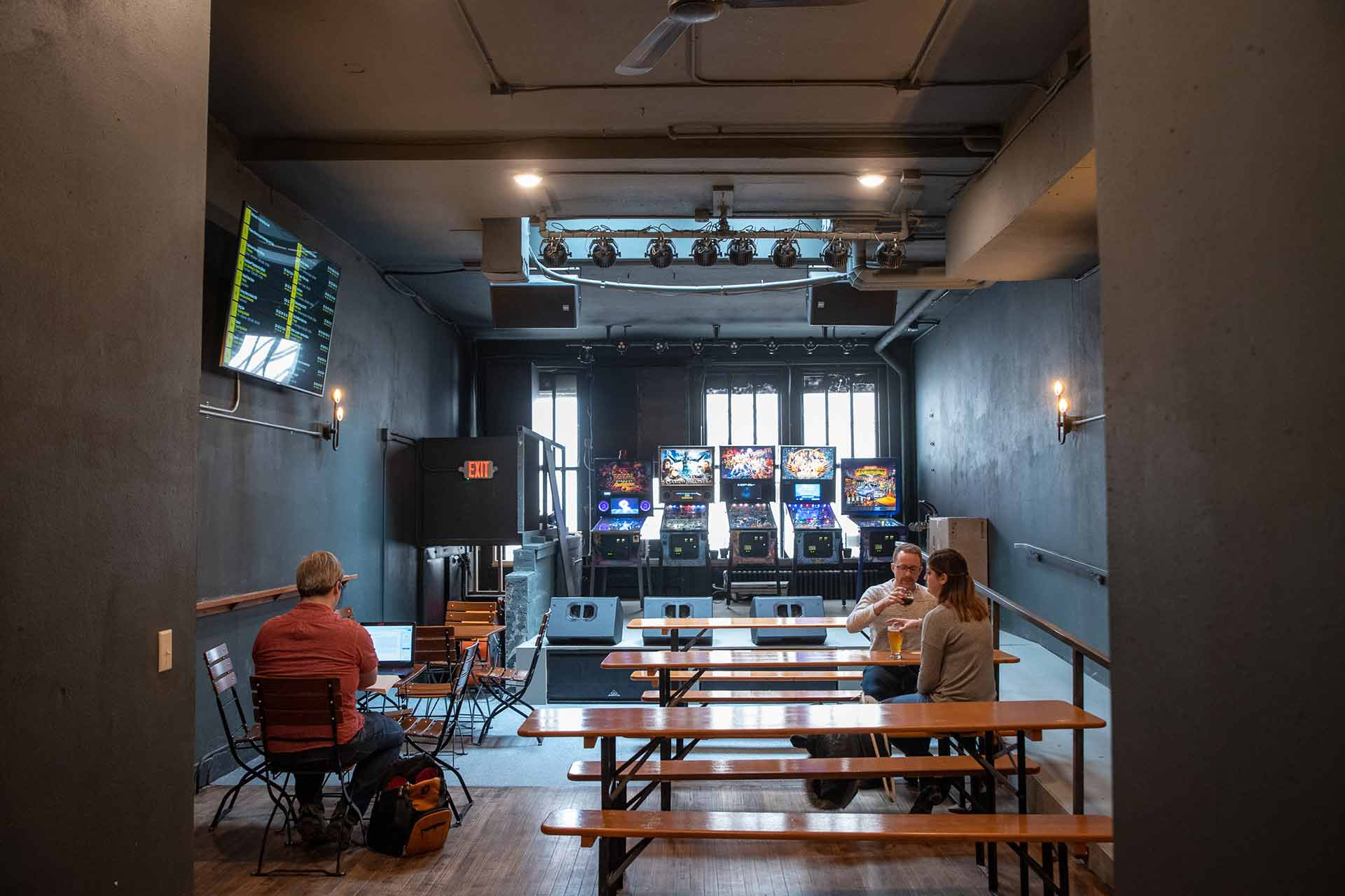 A look toward the back of BarleyPop Live, including pinball machines