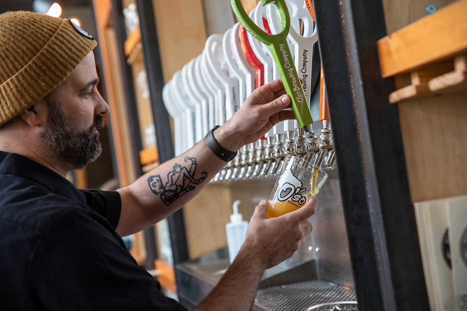 Chad Kersey pours beer at Madhouse