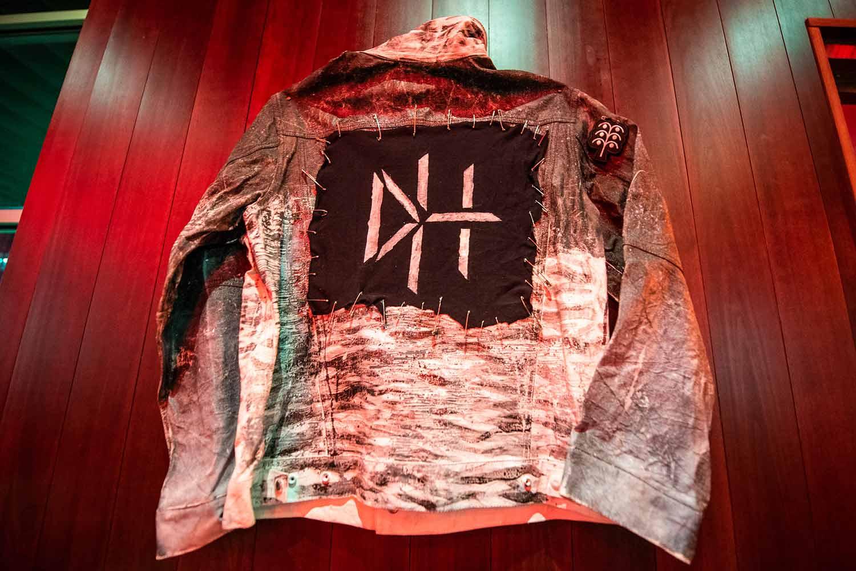 DarkHorse jacket hangs on a wall